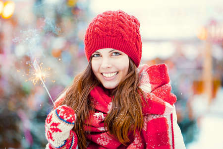 Happy girl with sparkler outdoors