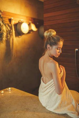 Young girl in spa salon Фото со стока