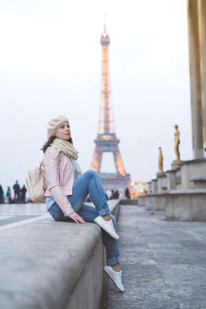 Young girl at the Eiffel Tower Stock Photo