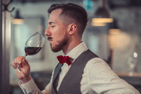 Young man tasting wine