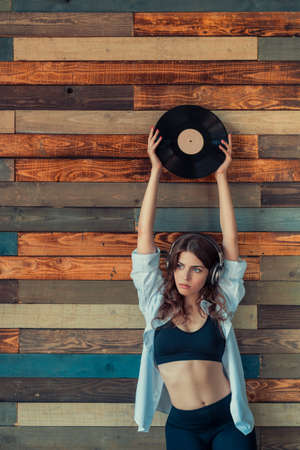 Young woman with a phonograph record Stock Photo