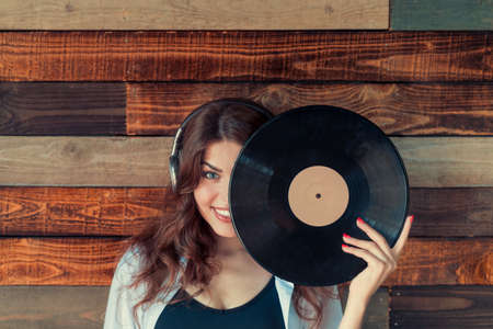 Smiling girl with a phonograph record