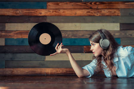 Attractive girl with a phonograph record
