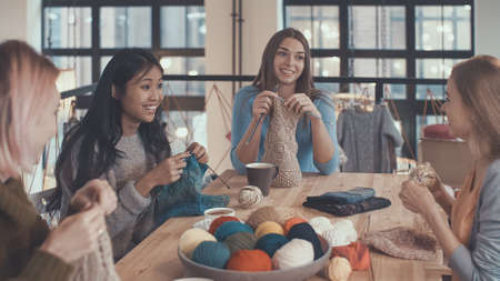 Young women in knitting studio