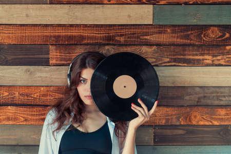 Young girl listening to music in studio Reklamní fotografie