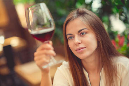 Young woman with a wineglass