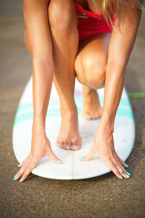 Young girl on surfboard close-up