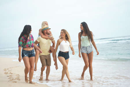 Happy young people on the beach