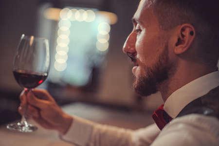 Young man with a wine glass Reklamní fotografie