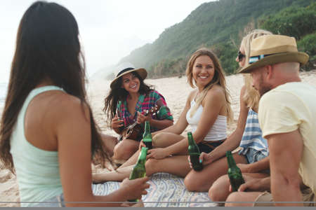 Young happy friends on the beach