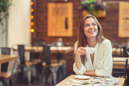 Smiling young girl in a cafe