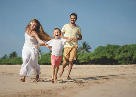 Smiling family on the beach
