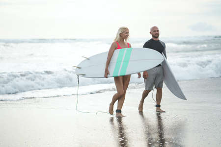 Sports people with a surfboards outdoors Reklamní fotografie