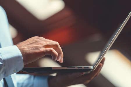 Businessman with laptop close up
