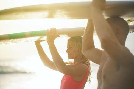 Young surfers on the beach Reklamní fotografie