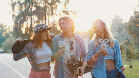 Young smiling people with skateboards in the park Stock Photo