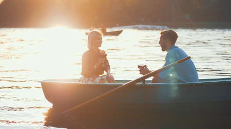 Young couple with a glass of wine in the sunlight Reklamní fotografie
