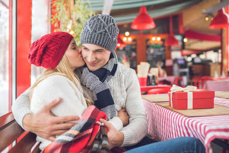 Young couple in a cafe at Christmas