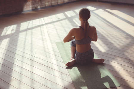 Young woman practicing yoga in the sunlight