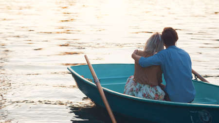 Embracing couple in a boat
