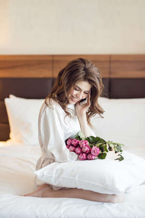 Beautiful woman with a bouquet of flowers