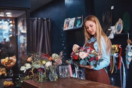 Young florist with flowers Stok Fotoğraf