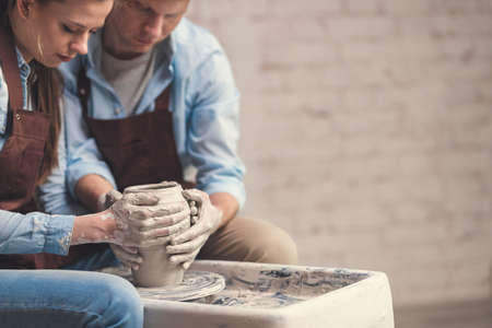 Young couple at the potters wheel