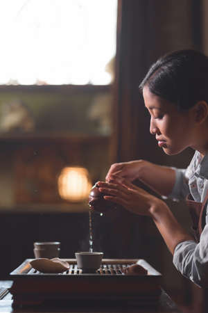 Young girl pouring tea