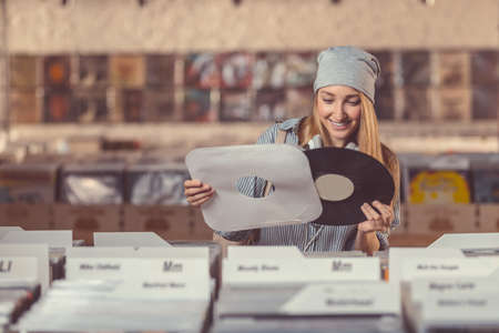 Smiling girl in a vinyl record store