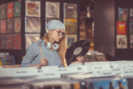 Young girl in a vinyl record store Stock Photo
