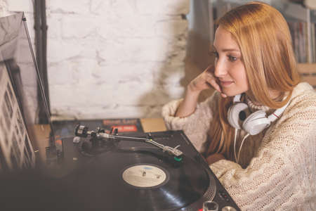 Young girl listening to a record Stock Photo