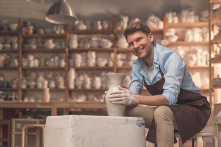 Smiling master at the potters wheel Standard-Bild