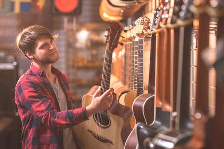 Young musician choosing a guitar