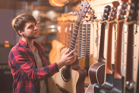 Young customer in a music store Stock Photo