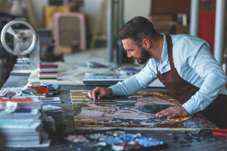 Working man with a mosaic
