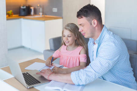 Young father with a daughter at home