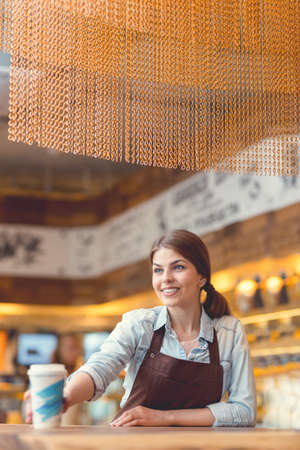 Attractive woman with a coffee at the counter Stock Photo
