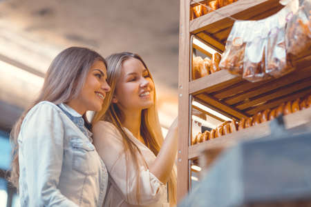 Attractive girls in the bakery Stock Photo