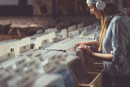 Attractive girl in a vinyl store Stock Photo