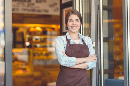 Young owner in uniform Stock Photo