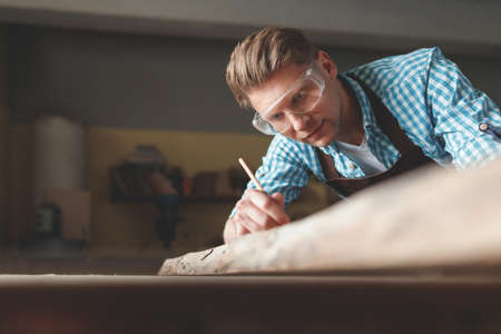 Young man with glasses at work
