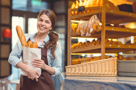Smiling woman in the bakery Stock Photo