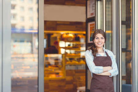 Young owner in a bakery Stock Photo