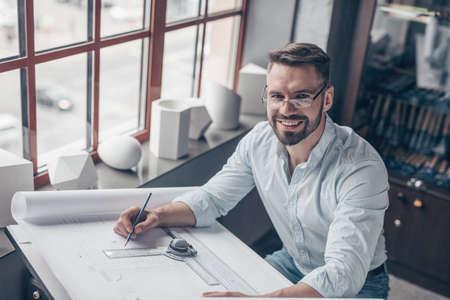 Smiling mature engineer at work