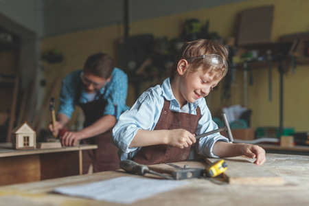 Little boy in the carpentry Reklamní fotografie