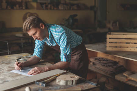 Young carpenter in the carpentry