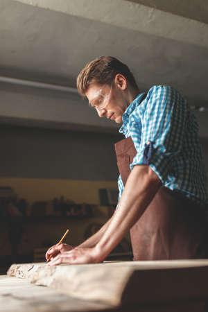 Young carpenter in the workshop Reklamní fotografie