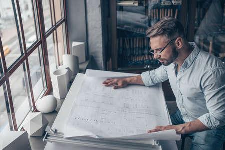 Mature architect with a plan Reklamní fotografie