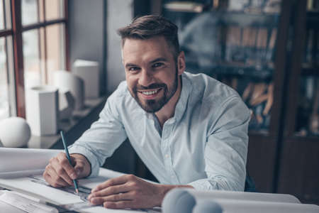 Smiling professional in the workplace
