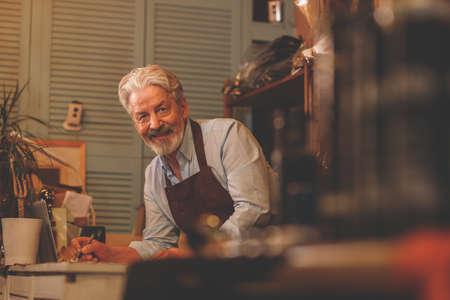 Smiling elderly man at work Reklamní fotografie
